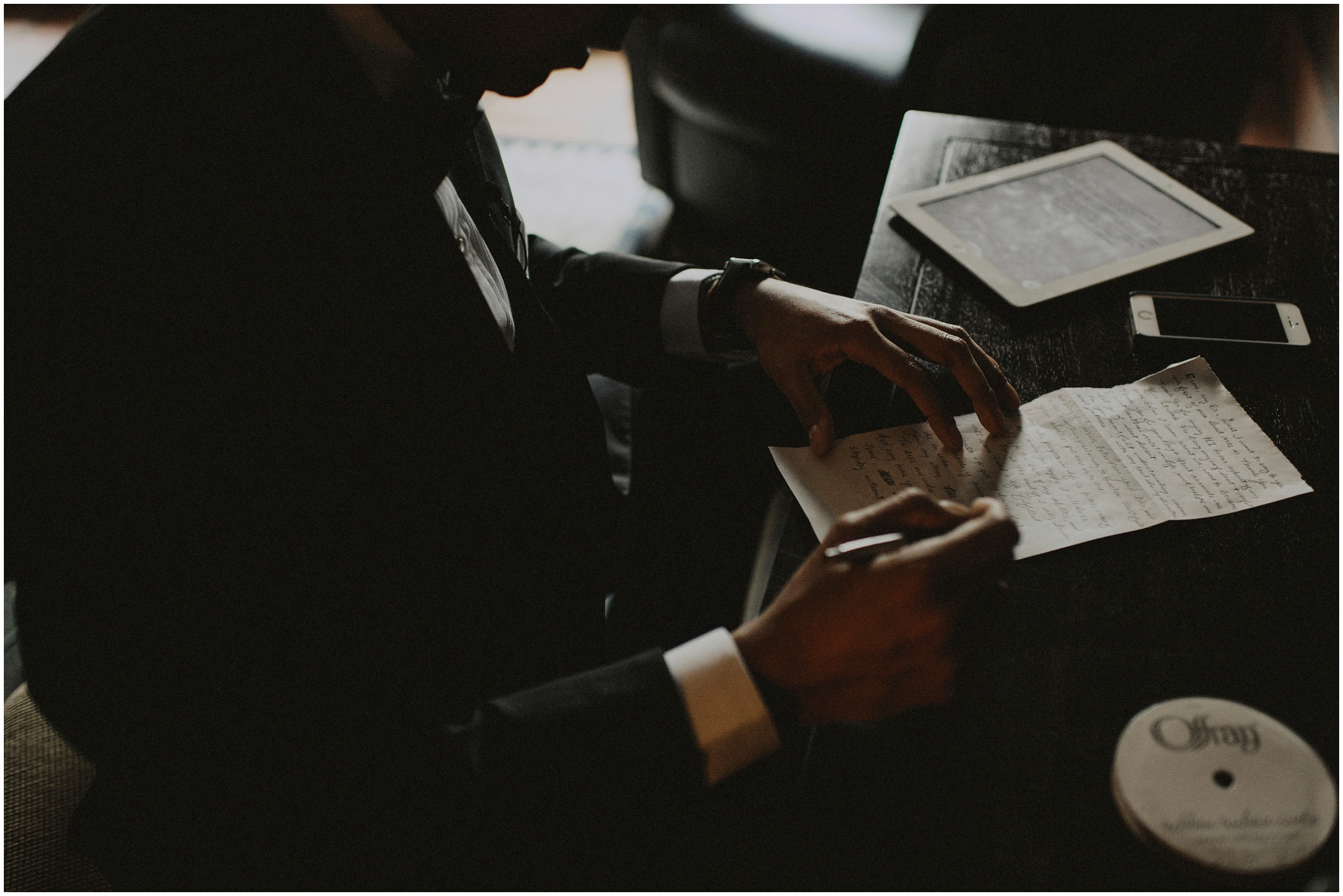groom writing a letter to his bride