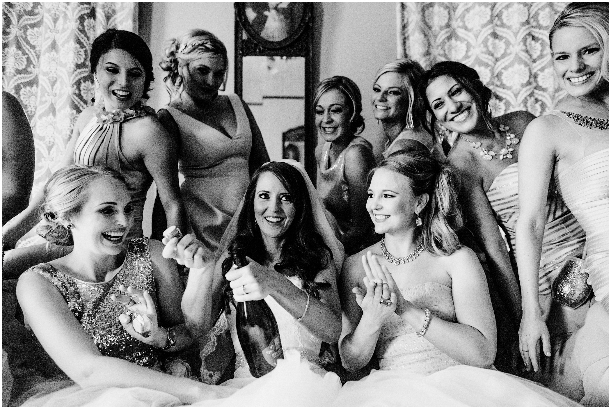 bride and her bridesmaids have champagne
