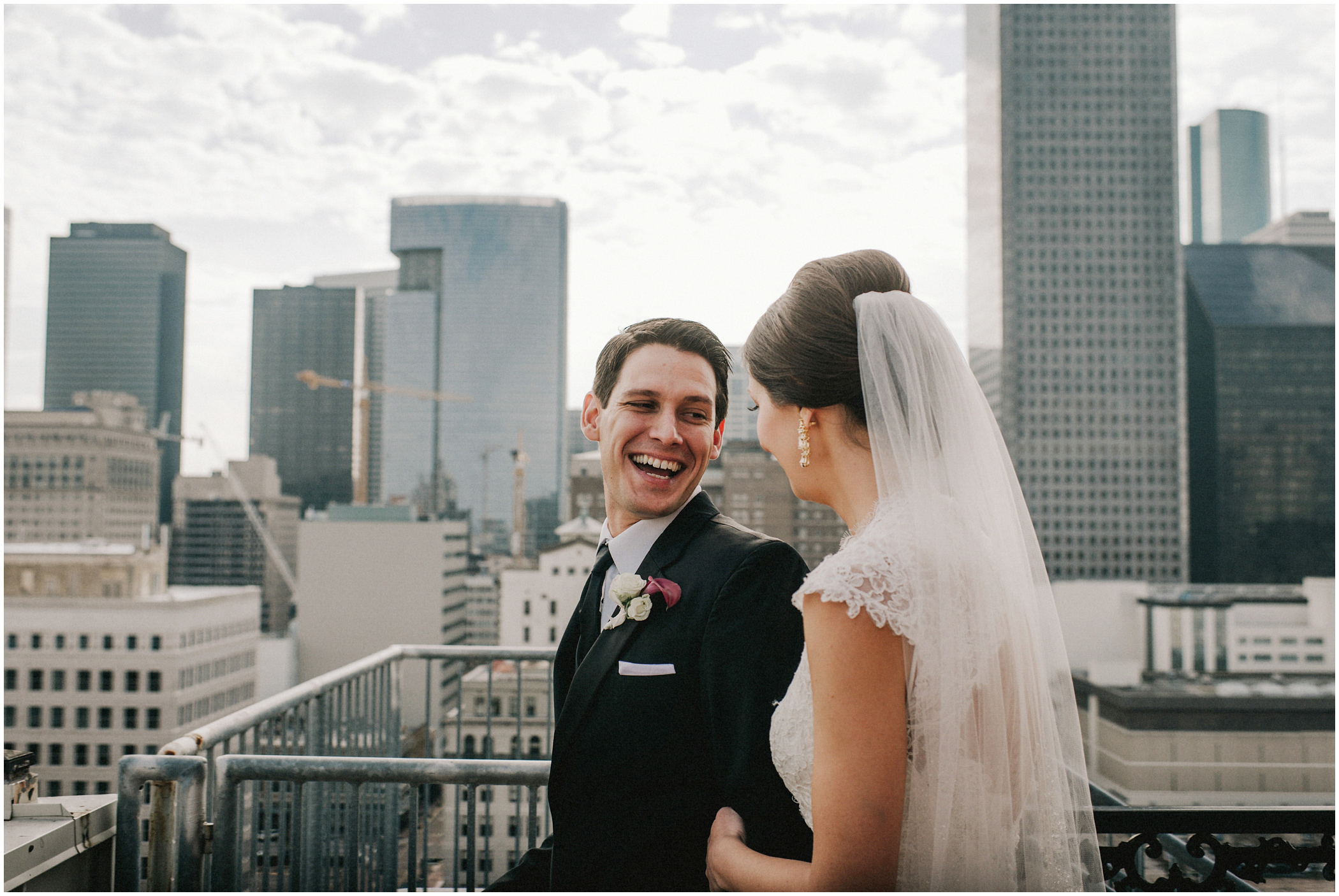 bride and groom overlook the city