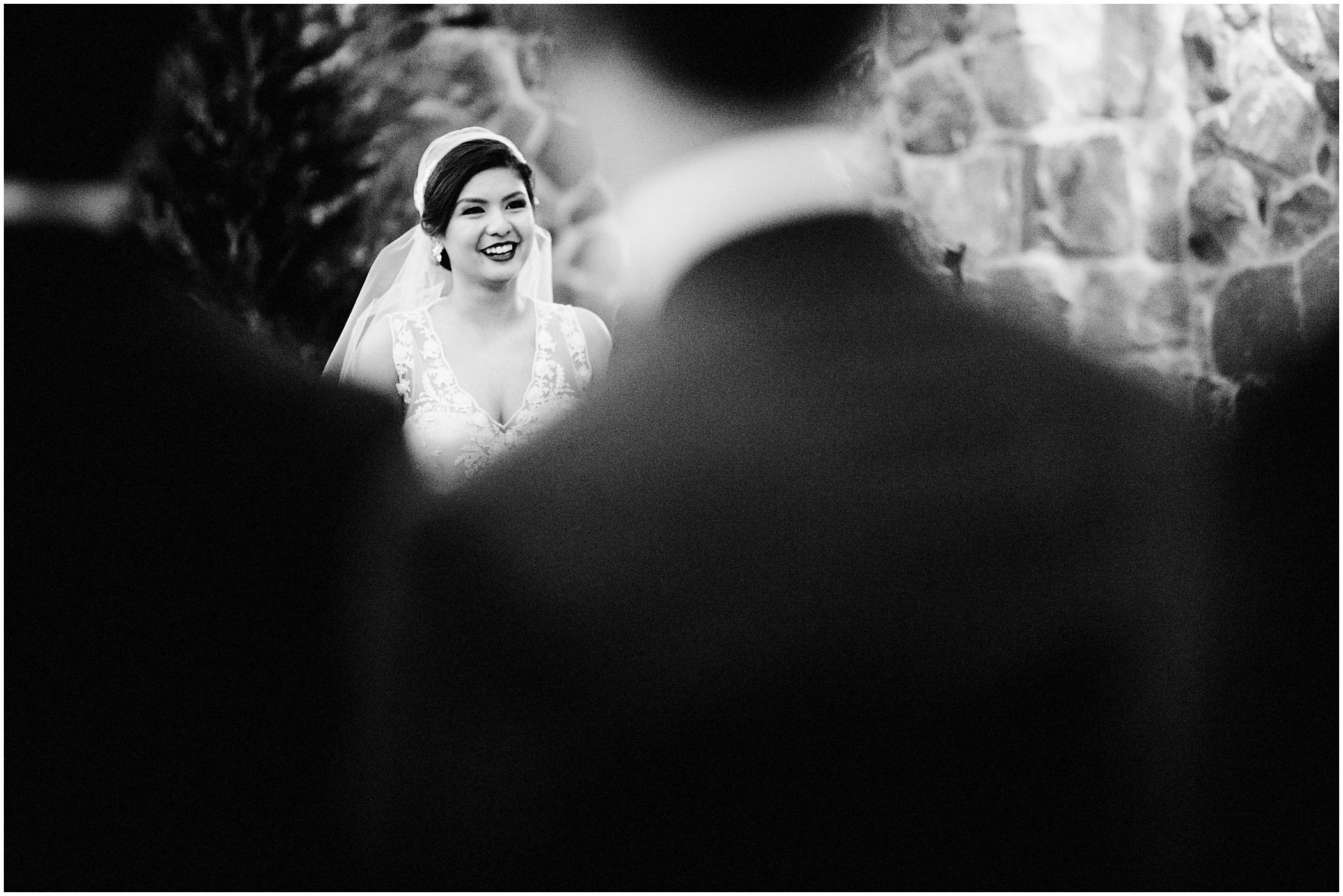 bride walks toward her groom