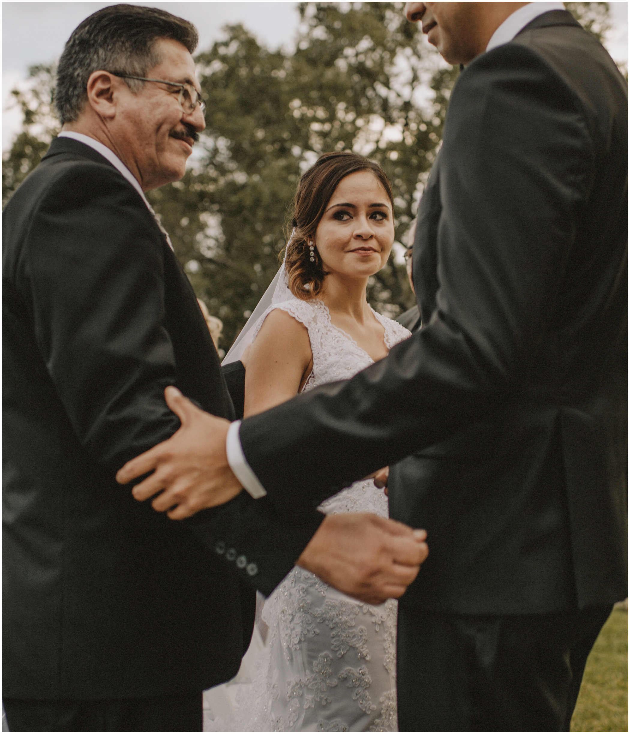 father gives his daughter away at her wedding