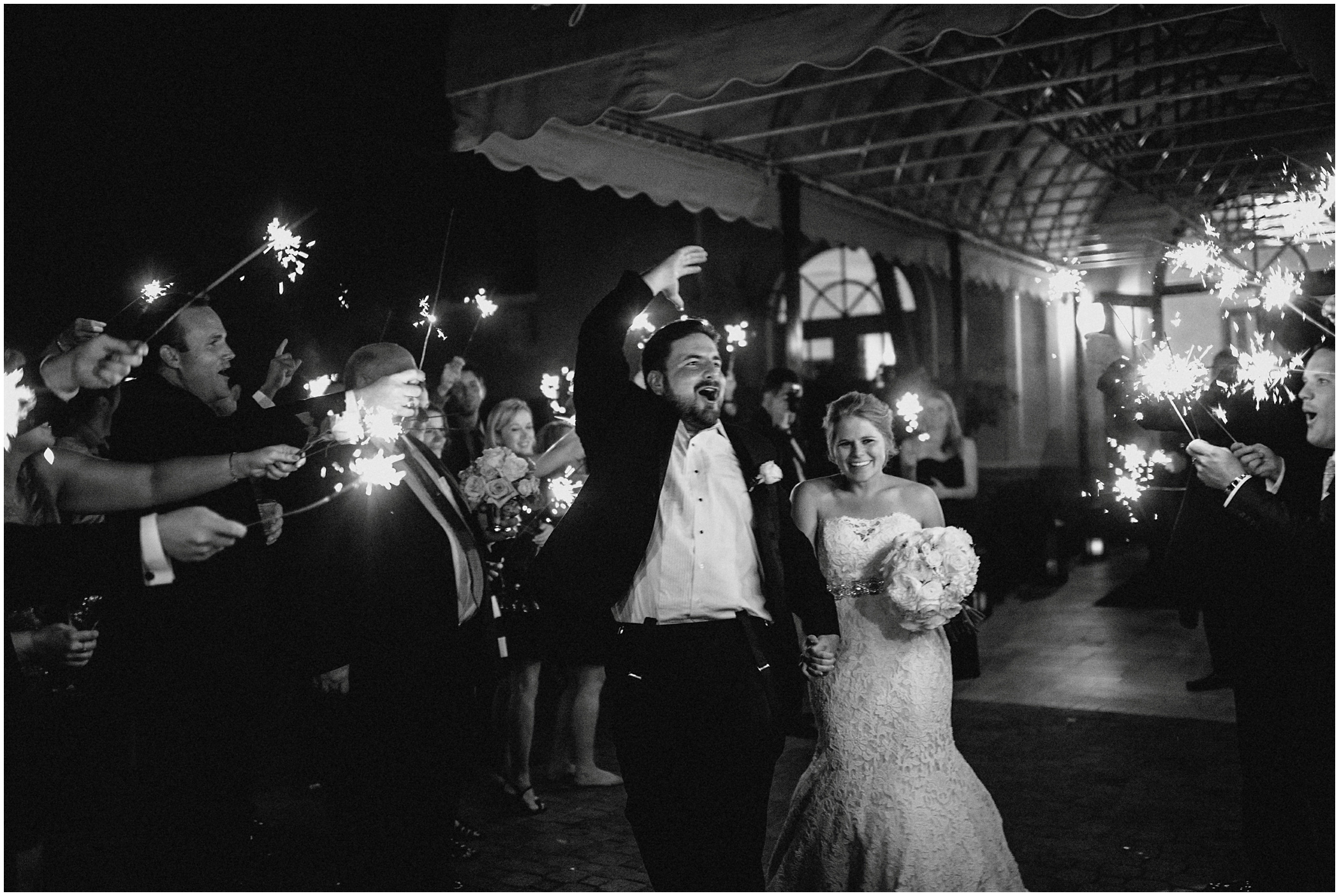 couple exiting wedding with sparklers