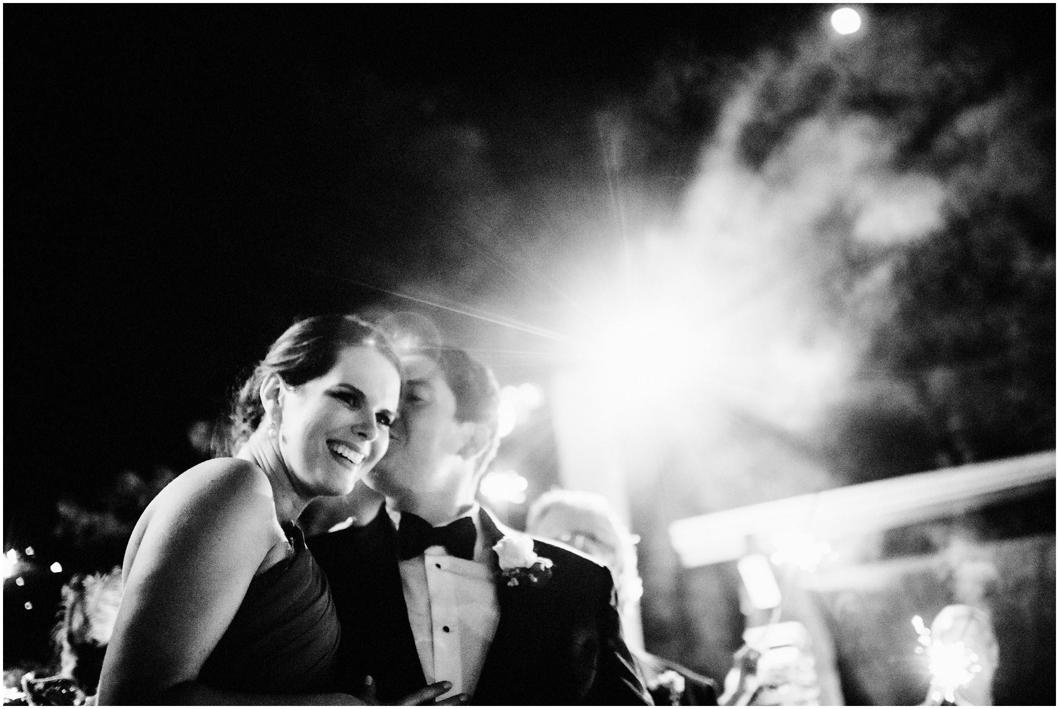 bride and groom exit their wedding reception
